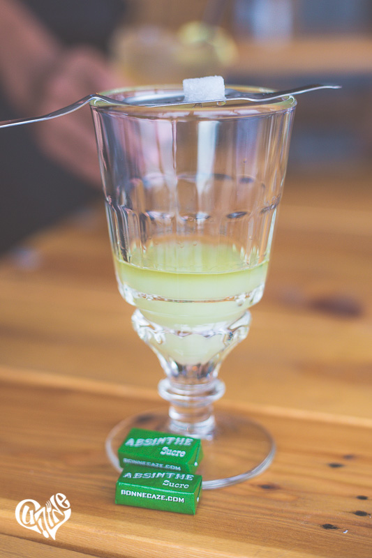 The precipitated oils in absinthe caused by louching